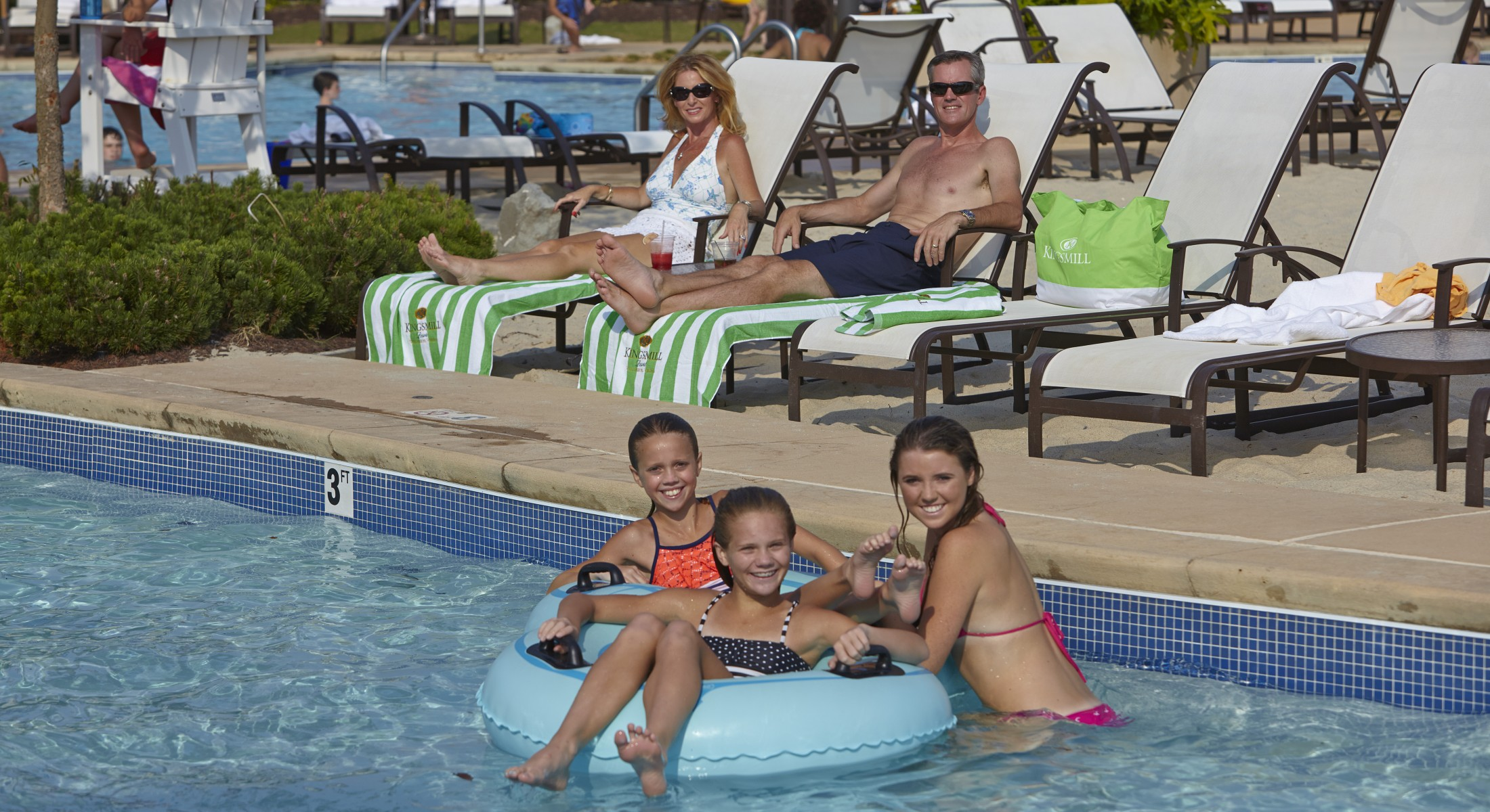 Family in outdoor pool