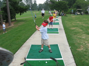 Young kids at the driving range