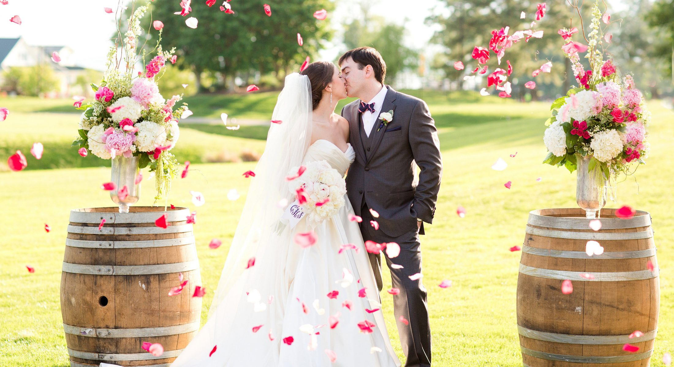 Wedding Couple with Flower Pedals Flying Around Them