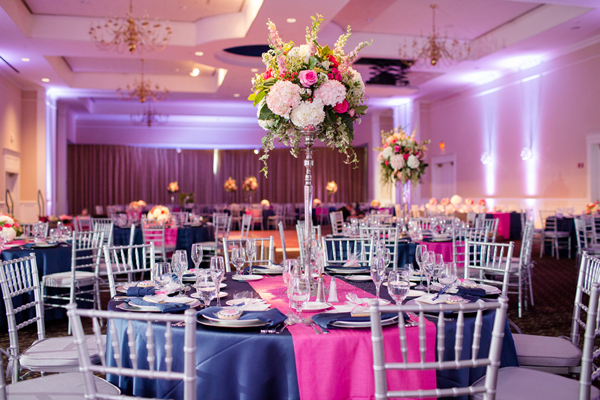 Wedding Reception Setup with Pink and Dark Purple Theme