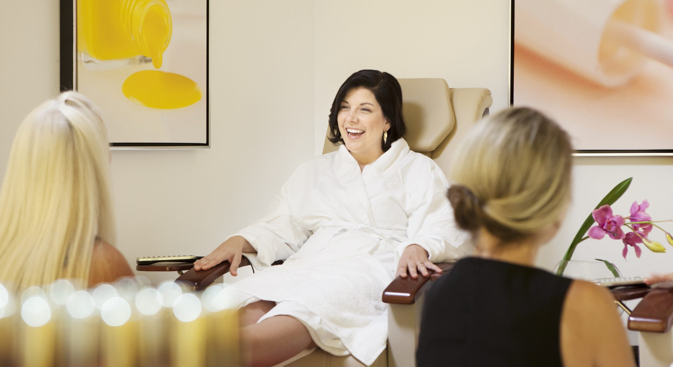 Lady Smiling and Getting a Pedicure