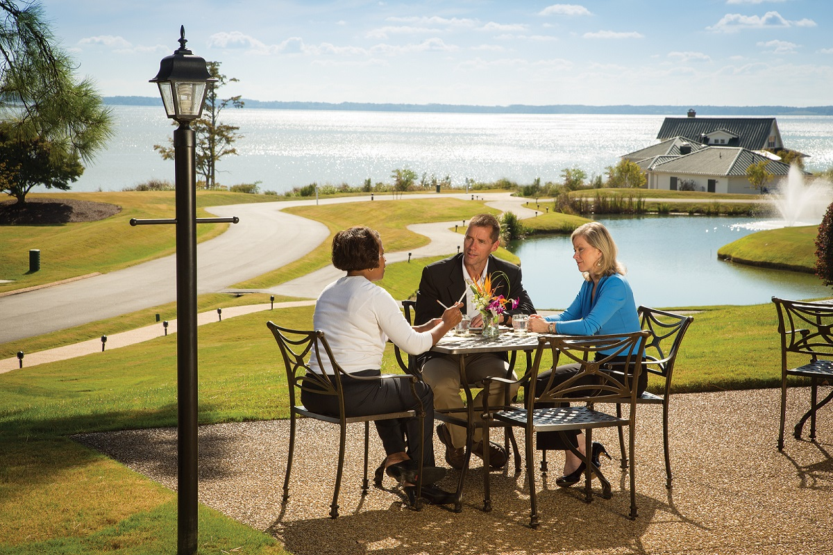 3 Business Professionals Dining Outdoors