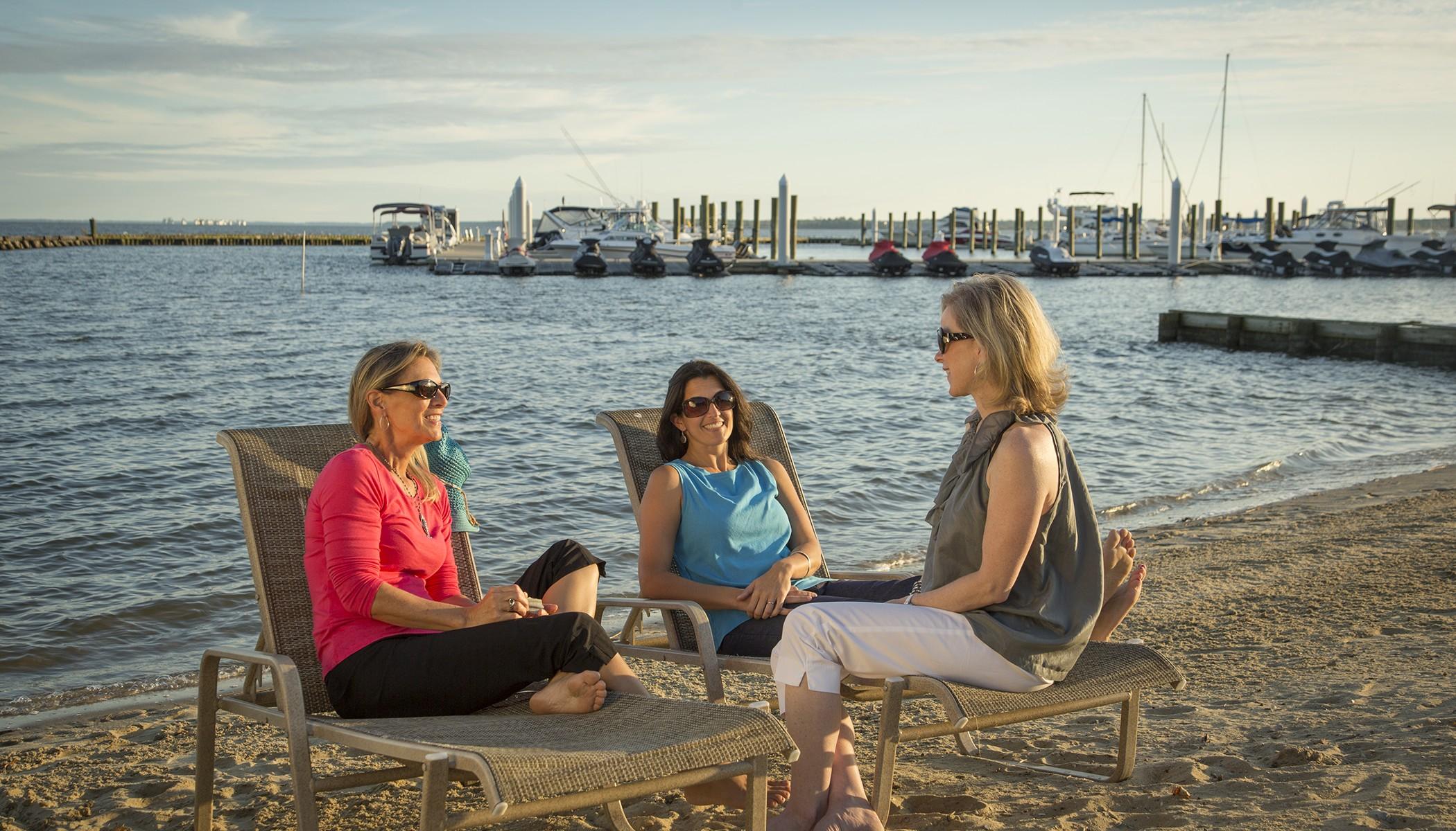 3 Women Socializing on the beach