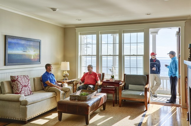 Living Room of Cottage With 4 Men