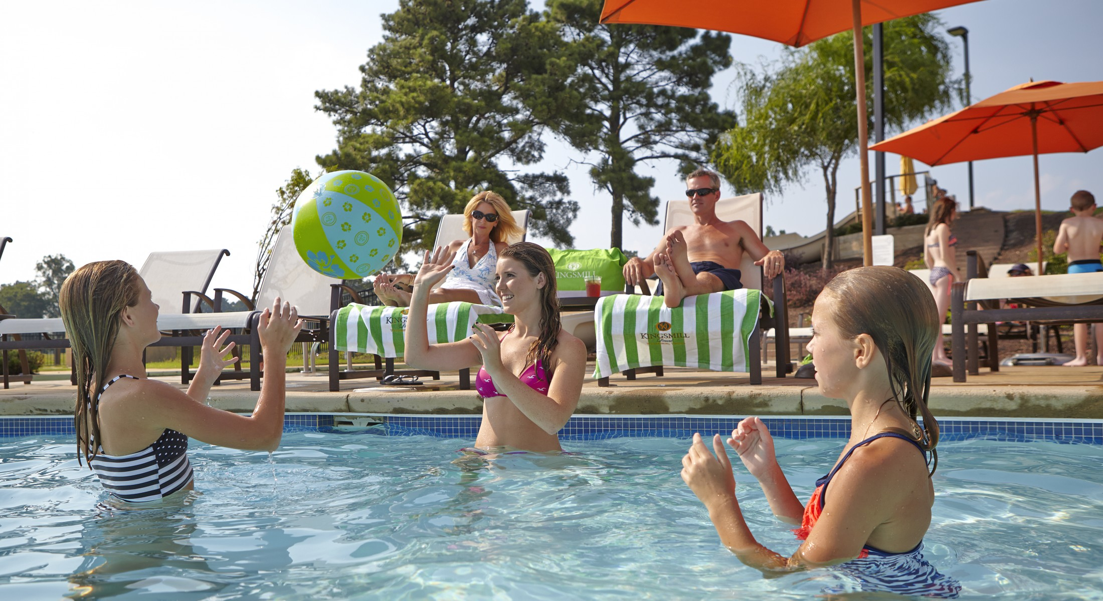 3 Girls Playing with Beach Ball in Pool