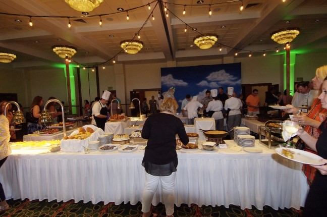 Large Buffet Setup with Lady Making Plate