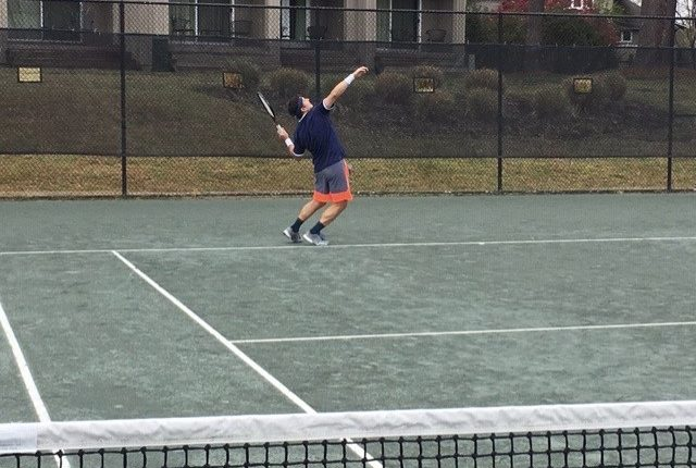 Joe Napoleon Serving Tennis Ball