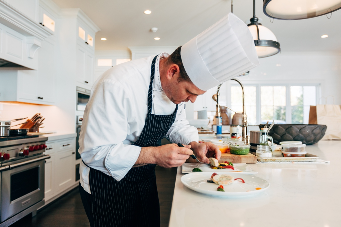 Dedicated Estate Chef preparing a personalized meal
